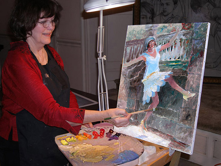 Demonstrating painting for an arts group.